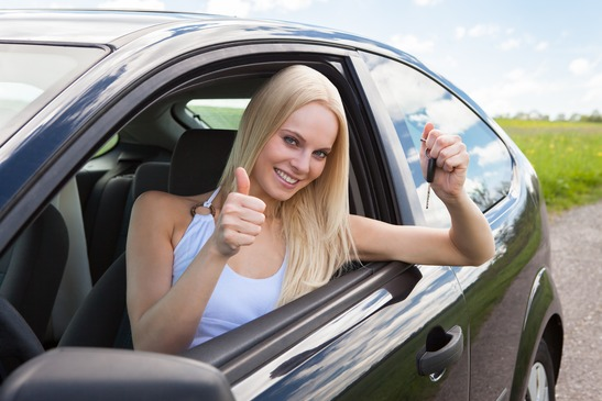 Happy Woman In A Car Showing A Key